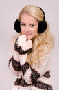 Winter girl with earmuffs beautiful fashionable in brown and gold clothes in and wears Stock Photography