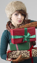 Winter girl with gifts Royalty Free Stock Photo