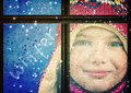Winter girl a little with a behind a rainy window in Stock Photos