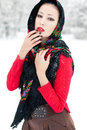 Winter girl in red cardigan with russian kerchief and luxury fashion accessories posing the park forest snowflakes on clothing Stock Photos