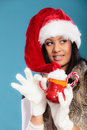 Winter girl santa helper hat holds red mug Royalty Free Stock Photo