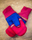 Winter gloves colorful fleece on a wooden table Royalty Free Stock Photo
