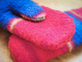 Winter gloves colorful fleece on a wooden table Stock Images