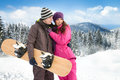 Winter holiday couple having leisure time on vacation Stock Image