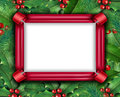 Winter holiday frame with a red ribbon and christmas holly with with red berries and green leaves with evergreen pine needles on a Stock Images