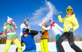 Winter holiday group of friends have a snowball fight Royalty Free Stock Images