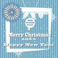 Winter holidays blue holiday greeting with the text we wish you a merry christmas and a happy new year Stock Images