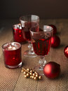 Winter hot drink tea or mulled wine with cinnamon and christmas decoration shallow focus Stock Photography