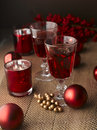 Winter hot drink tea or mulled wine with cinnamon and christmas decoration shallow focus Royalty Free Stock Images