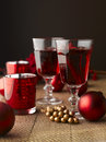Winter hot drink tea or mulled wine with cinnamon and christmas decoration shallow focus Stock Image