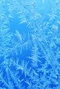 Winter ice frost, frozen background. frosted window glass texture. Cold cool icicles background. Winter wonderland scene. Royalty Free Stock Photo
