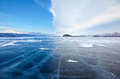 Winter ice landscape on lake Baikal with dramatic weather clouds Royalty Free Stock Photo