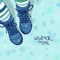 Winter illustration with girls feet in boots striped tights and on a snowflake patterned background Stock Images