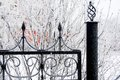 Winter iron fence details of black with frost closeup during wintertime Stock Image