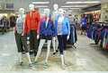Winter jackets for women on mannequins multi colored displayed at a shopping mall in hong kong Stock Image