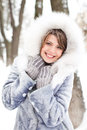 Winter joy woman enjoying outdoors while snowing Stock Photography