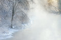 Winter kalamazoo river in fog foggy landscape of the framed by frosted trees michigan usa Royalty Free Stock Photography