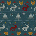 Winter knitted pattern with deer and fox Royalty Free Stock Photo