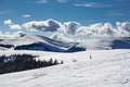 Winter landscape image showing the carpathian mountains covered in snow on a sunny day Royalty Free Stock Photography