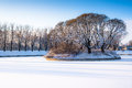 Winter landscape island in the forest lake Stock Image