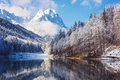 Winter landscape with lake and reflection mountain Royalty Free Stock Photos
