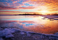 Winter landscape with lake and sunset fiery sky composition of nature Royalty Free Stock Photo