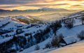 Winter landscape in mountainous rural area at sunrise Royalty Free Stock Photo