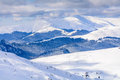 Winter landscape over Carpathian Mountains. Panorama of snow mountain range landscape with blue sky and white clouds from Royalty Free Stock Photo