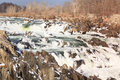 Winter landscape potomac river at great falls virginia a view of the raging cascading over rocks Stock Image