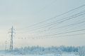 Winter landscape with power line. Royalty Free Stock Photo