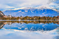 Winter landscape, reflection of lake and mountains with beautiful blue sky Royalty Free Stock Photo