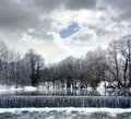Winter Landscape with River, Waterfall and Clouds Royalty Free Stock Images