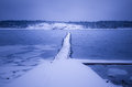 Winter landscape by the sea blue with a jetty Royalty Free Stock Photography