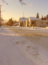 Winter landscape street and church covered by snow Royalty Free Stock Photo