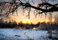 Winter landscape with sun and frozen river sunset Royalty Free Stock Images