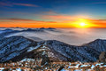 Winter landscape with sunset and foggy in Deogyusan mountains. Royalty Free Stock Photo