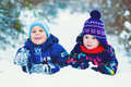 stock image of  Winter Lifestyle Concept - Kids Having Fun in Park