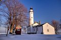 Winter lighthouse beautiful point aux barques bathed in the warmth of the afternoon sun on a cold winters day park port hope Royalty Free Stock Photography
