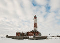Winter lighthouse the island in the on the ladoga lake russia Stock Photo