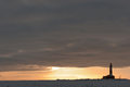 Winter lighthouse at sunset the island in the on the ladoga lake russia Royalty Free Stock Photos