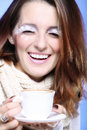 Winter makeup woman with cup of hot latte coffee fashion stylish holding drink time for enjoyment blue background Stock Photography