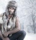 Winter male fashion portrait of model wearing fur in wonderland Royalty Free Stock Image