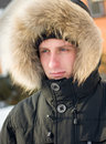 Winter - man in warm jacket with furry hood Stock Photo
