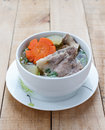 Winter melon soup with pork spare rib on wood background. Royalty Free Stock Photo