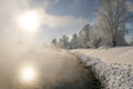 Winter morning on the river landscape misty at sunrise Royalty Free Stock Photo