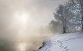 Winter morning on the river landscape misty at sunrise Stock Images