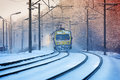 Winter morning train incoming suburban in the misty sunset Stock Photo