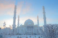 Winter mosque on the background of blue sky Royalty Free Stock Photo