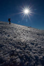 Winter mountain climbing descend on icy slope Royalty Free Stock Images