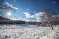 Winter mountain landscape stock photo snowy in the recent snowfall has covered the field and the trees Royalty Free Stock Images